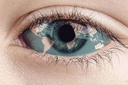 Earth continents painted on eye iris, concept save the planet. Image of earth painted on face skin. Creative composition of eye and planet earth. Elements of this image furnished by NASA .