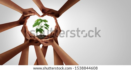 Earth day and earthday as group of diverse people joining to form heart hands connected together protecting the environment and promoting conservation and climate change issues as an image composite.
