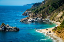 Earth day at one of the most amazing places on Earth , at Julia Pfeiffer State Park off the Coast of Central California with gorgeous bright blue pacific ocean water from the Pacific Ocean