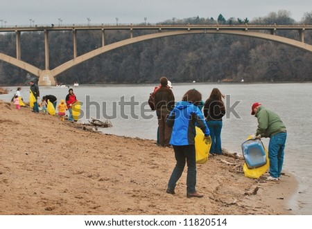 Earth Day Cleanup - group of people cleanup banks of Mississippi River in Minneapolis Minnesota