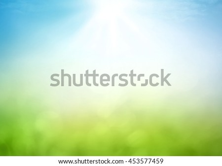 Earth day concept: Abstract blurred beautiful green bokeh light meadow and blue sky on autumn sunrise background