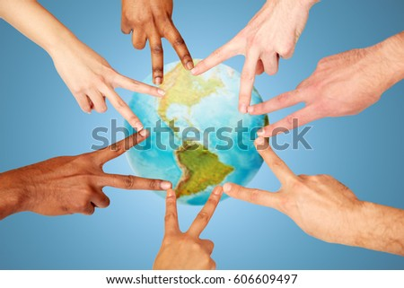 earth day, diversity, ethnicity, international people concept - group of hands showing peace hand sign over blue background and planet