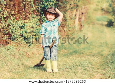 earth day. Eco life. summer activity. small kid gardener having fun. human and nature. farming and agriculture cultivation. happy child farmer play with garden shovel, spring. Forever young and free.