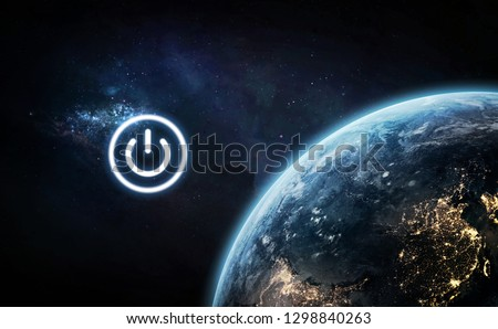 Earth Day theme. Earth hour. Poaer button near planet. Elements of this image furnished by NASA