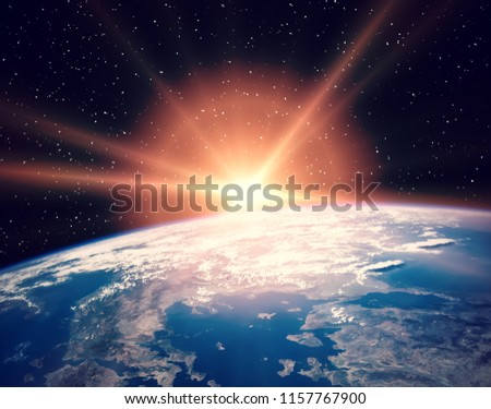 Earth from space during a sunrise. The elements of this image furnished by NASA. #1157767900