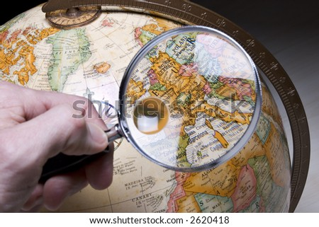 Earth Globe and magnifying glass