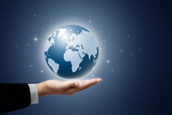 Earth globe in businessman hands on star and blue background