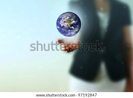 Earth globe in the Business woman hand. Photo earth from NASA satellite.