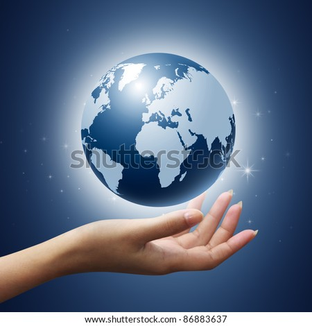 earth globe in woman hands on blue background