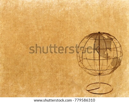 Earth globe on Old antique vintage paper background #779586310