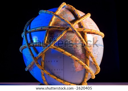 Earth globe wrapped with rope