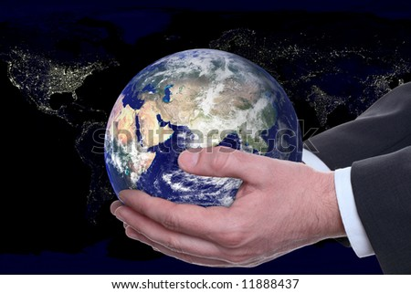earth in a hands on background night city