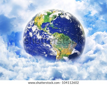 Earth in clouds. Elements of this image furnished by NASA.