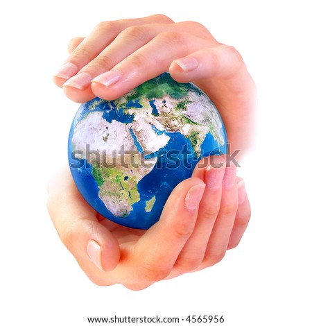 Earth in hands over white background - stock photo