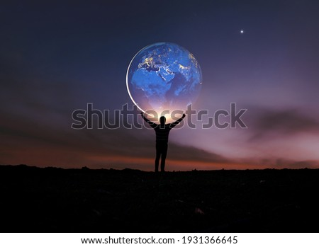 Earth in human hands. earth day. energy saving , elements of this image furnished by NASA