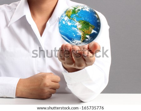 "earth in human the hand ""Elements of this image furnished by NASA"""