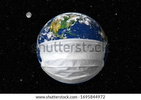 Earth in medical mask on star sky background, concept of Stop coronavirus in world and COVID-19 pandemic. Globe with protect from corona virus in outer space. Elements of image furnished by NASA.