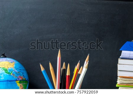 Earth model, pencils and earth model on chalkboard background