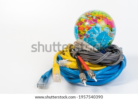 Earth model with internet cable or LAN cable concept for global internet communication and network connection concept, ethernet cable with RJ45 plug connector and Earth globalization. Stock fotó ©