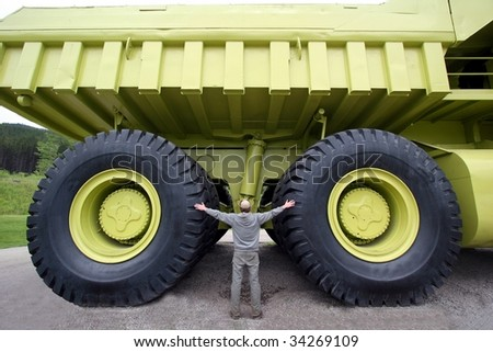 Earth moving dump truck with a man at the wheel