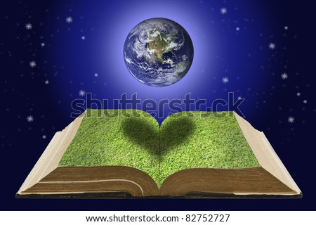 Earth over open book that has grass on it page on space background