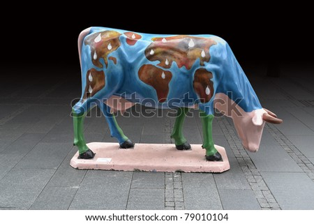 Earth painted cow statue