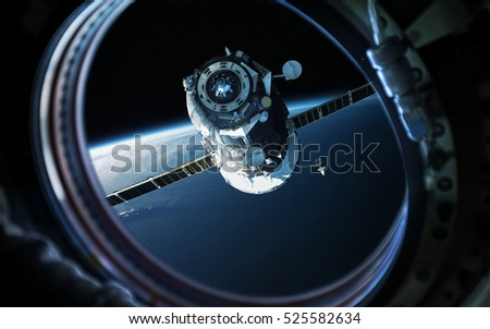 Earth planet in space ship window porthole. Elements of this image furnished by NASA