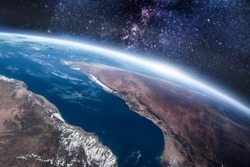 Earth planet with ocean and continent view from space. Stars and galaxies on background. Elements of this image furnished by NASA