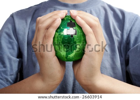Earth puzzle, held by a young boy looking for solution