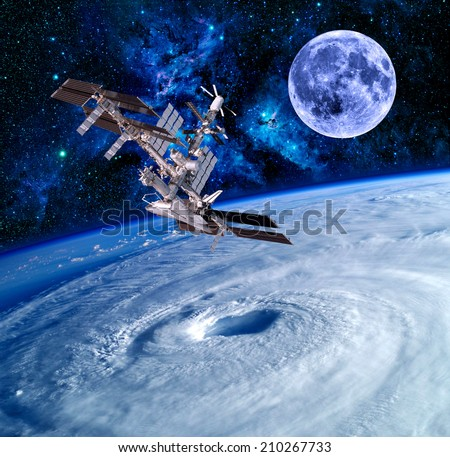 Earth satellite space station spaceship sky stars. Elements of this image furnished by NASA.