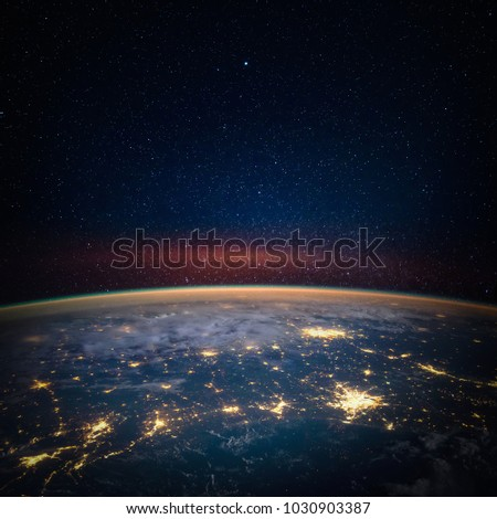 Earth, star and galaxy. Elements of this image furnished by NASA.