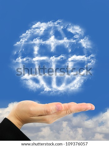 earth symbol made of clouds  over hand - stock photo