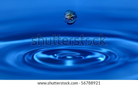 Earth within a water drop - stock photo