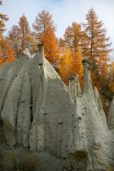 Earthen pyramids in the Dolomites of South Tyrol, on an autumn cloudy day. Vacation in Tyrol.
