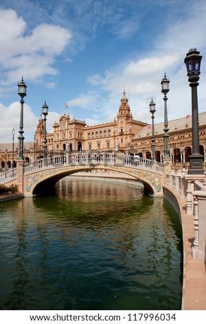 Earthenware small bridge on a canal, Plaza Espana, Seville, Spain.