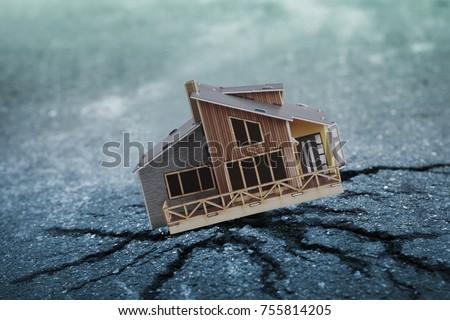 Earthquake crisis house risk insurance concept
