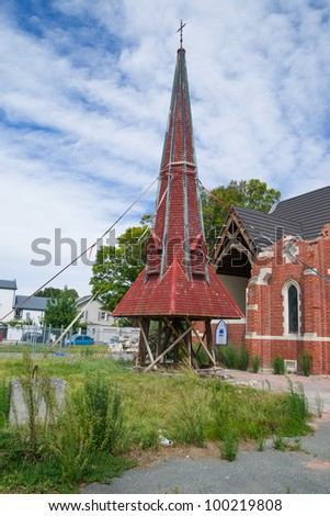 Earthquake damaged church in Christchurch, New Zealand shows steeple sitting on ground