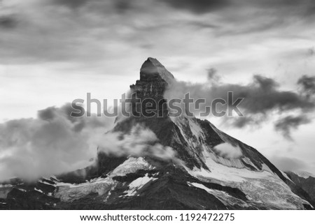 Earthy Black&White Matterhorn with dramatic clouds, snwofields, glacier