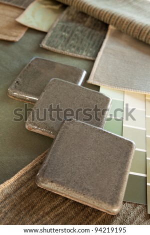 Earthy green & brown interior design plan with fabric and paint color swatches, and ceramic tiles.