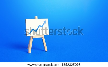 Easel and up arrow chart. Concept of success, growth and performance improvement. Statistics and business analytics. Income revenue statement analysis. High efficiency, productivity. Economic progress