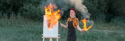 Easel in fire. Woman with fire brush and palette