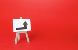 Easel with a right turn arrow. Minimalism. Direction to go around on the left. Advertising. Obscure obstacles, move towards the goal. New rules. Copy space