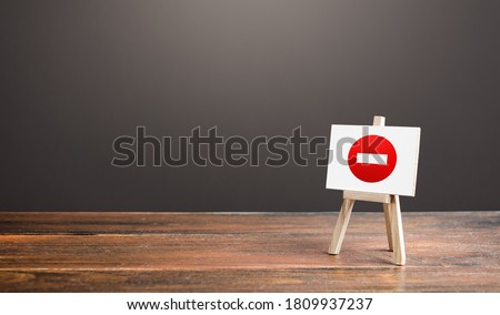 Easel with no entry symbol. Prohibition of actions and operations, restricted area. Ban and sanctions. Isolation zone and quarantine. Wrong direction. Failed strategy. Inaccessibility, taboo. Сток-фото ©