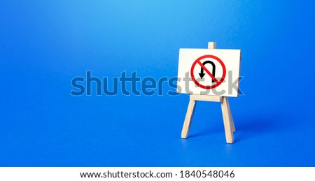 Easel with no turning back traffic sign. Turn arrow and red prohibition symbol. Assertiveness and striving, moving forward without retreating. Finish goals. No way back. Obstinacy, irrevocability Сток-фото ©