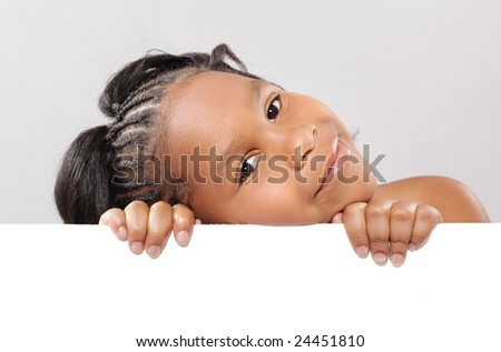 Easily expandable copy space being held by a cute little girl
