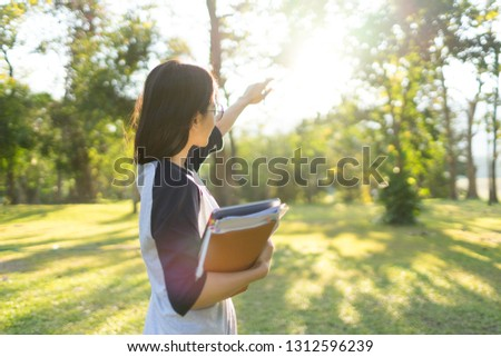 east Asian Female Student happy and feeling Good in university and holding Book and notebook #1312596239