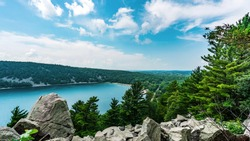 East Bluff trail in Devil's Lake State Park near Baraboo, Wisconsin, USA overlooking the majestic view of the serene body of water and rolling hills in the Midwest.