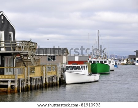 east coast fishing village Fisherman Cove Eastern Passage in Nova Scotia Canada; Halifax in the background