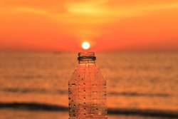 East collected water bottle /  bottle with sunset background / Sun agreed to design a water bottle /sunset and bottle