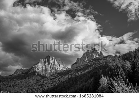 East face of Vallaccia mountain group summits Sas de la Dodesc, Sas de la Undesc and Sass Aut, subgroup of Marmolada group, as seen from Vigo di Fassa village, Dolomites, Italy. Stock fotó ©